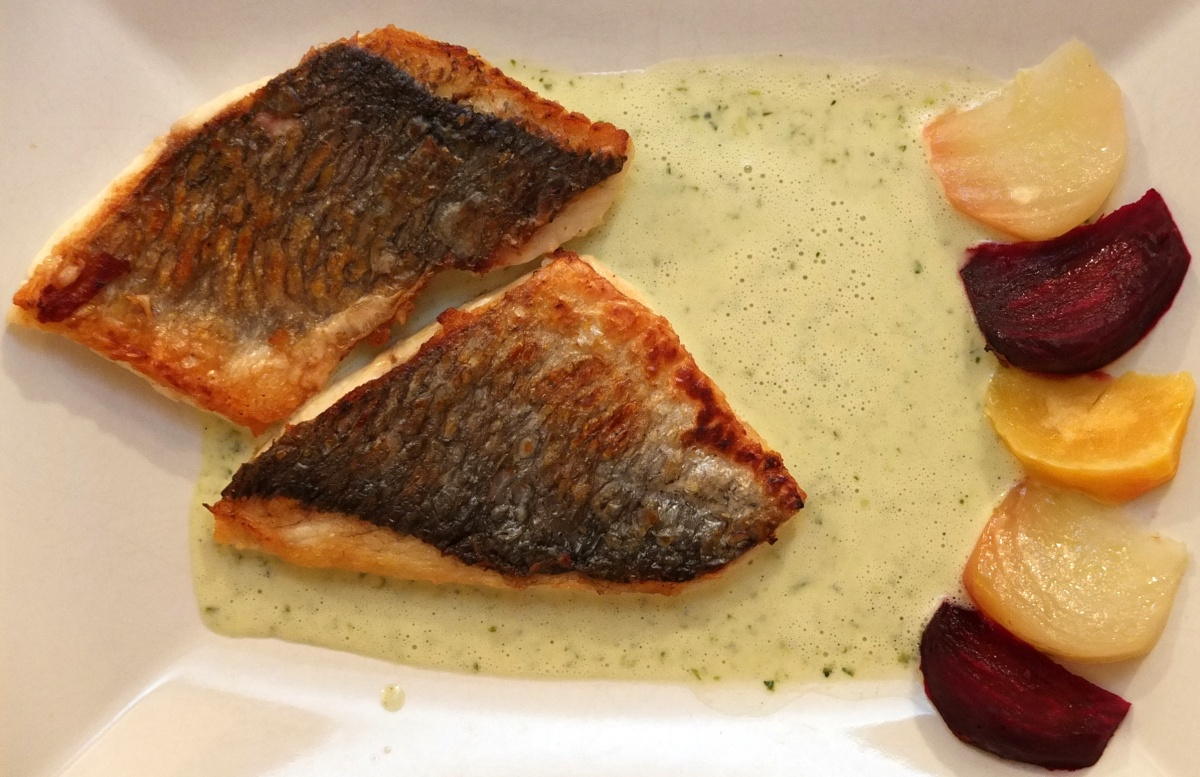 'Fillet of bream, lightly cooked with a crusty skin, green sauce
